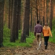 Photo of couple walking in woods from Roman Purtov on Unsplash.